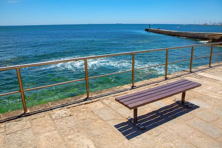 empty bench at the sunny seaside
