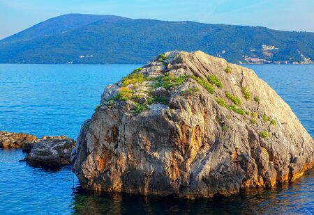 Sea scenery with rock foundation in the water