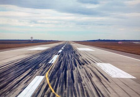 airport runway with traces of landing