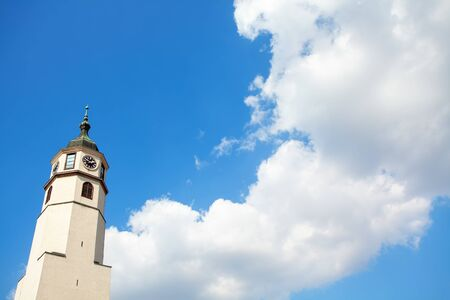 belfry with christian cross and clouds on blue sky Archivio Fotografico