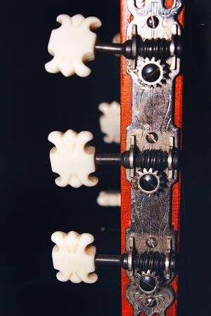 Acoustic Guitar Picks at Dark Background
