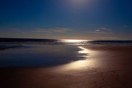 Night tide in the moonlight . Ocean coast illuminated by the moon Stok Fotoğraf