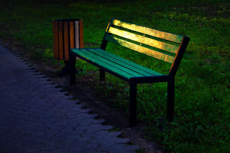 Empty Bench with Sunlight Reflection in the Park