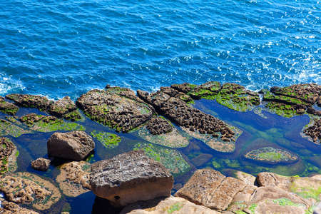 rocky ocean shore and blue water