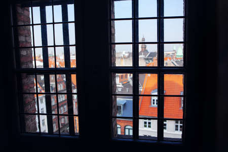 Looking to Central Copenhagen through the Window  . View of Old Danish Town 写真素材