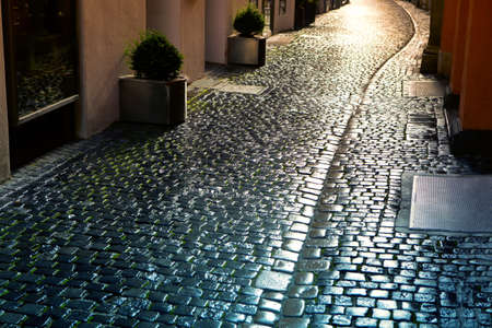Cobblestone Road with Sunlight . Narrow Street in Old Town 写真素材
