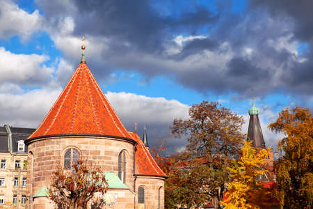 Nuremberg Johannisfriedhof Cemetery in the Autumn . Scenery with church and colorful trees