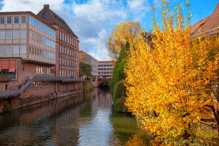 Nuremberg in the autumn . Pegniz river  in old german town