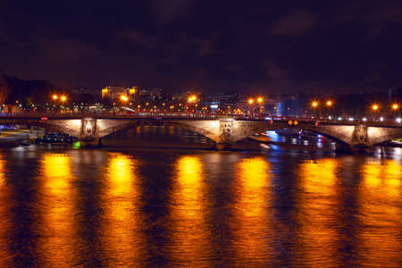 Pont des Invalides In the night illumination . Night view of Seine river and bridge in Paris