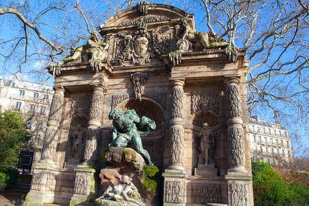 Decorative fountain with sculptures in Paris . Fountain Medici in Luxembourg Garden