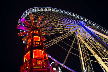 Ferris Wheel at Night . Amusement Park Illuminated in the Night