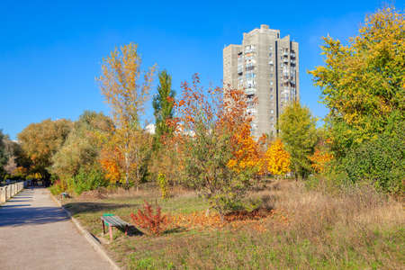 Residential house and autumn park . House in Soviet Union style .Rybnitsa city in Moldova, under the administration of the breakaway government of Transnistria