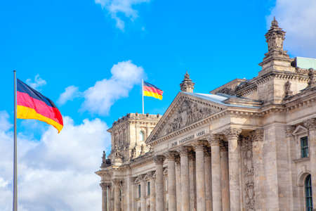 Reichstag building and german flags in Berlin