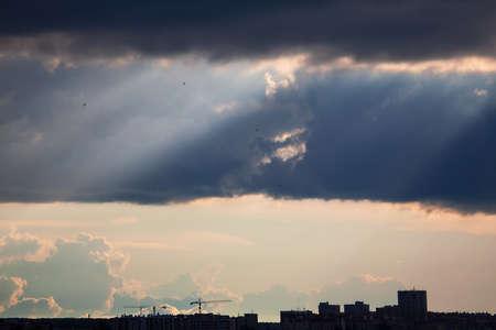 Rays in black clouds . Stormy weather in the city Zdjęcie Seryjne