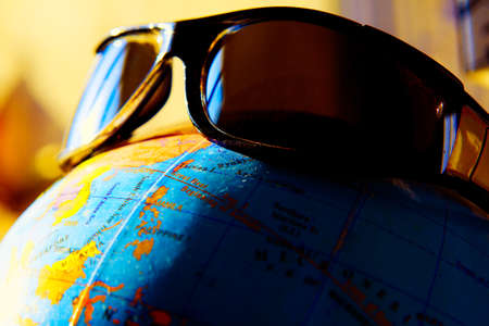 Sunglasses on the globe . Summer vacation concept