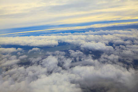 Clouds from Airplane Window . Flight over the clouds and river