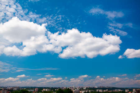 Summer afternoon sky with white clouds over the city Stok Fotoğraf - 155176939