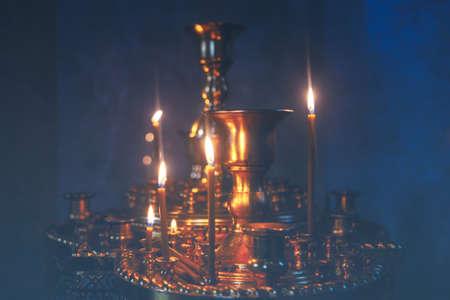 Candelabrum inside the worship . Burning candles during the praying Stock Photo