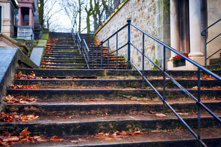 Autumn leaves on the cemetery staircase . Stairs to the graveyard Stock fotó