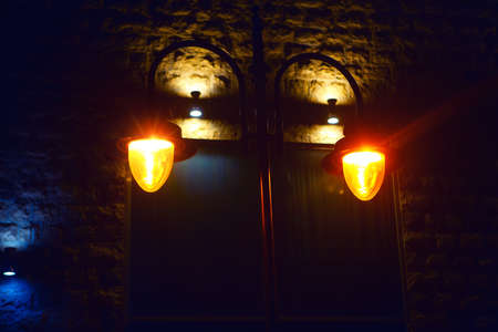 Old street lamp light . Medieval town illuminated in the night Stok Fotoğraf - 154904275