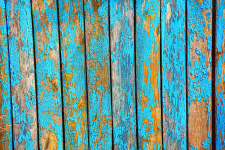 Old paint with cracks on the fence . Old wooden planks texture Stock Photo