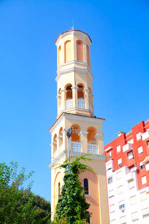 Islamic bell tower in the city Stok Fotoğraf - 154894424