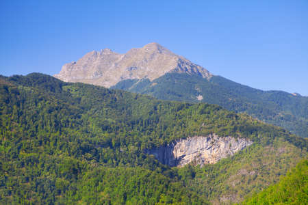 Mountain with grey peak and green base Stok Fotoğraf