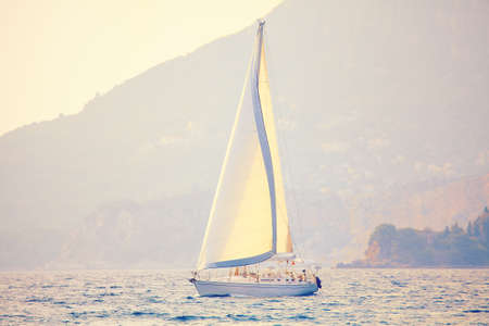 Yacht with a large mast . Modern luxury boat sailing in the twilight Stok Fotoğraf - 154895532