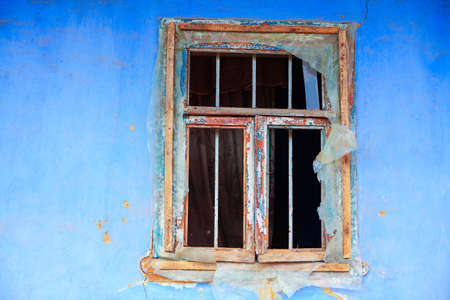 Wooden window of old abandoned house