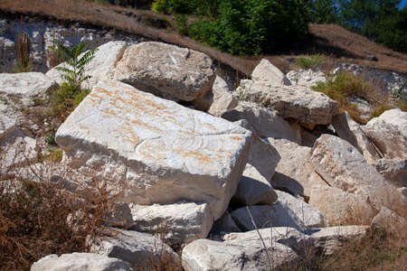 Big stone blocks . Abandoned quarry Stok Fotoğraf - 155075548