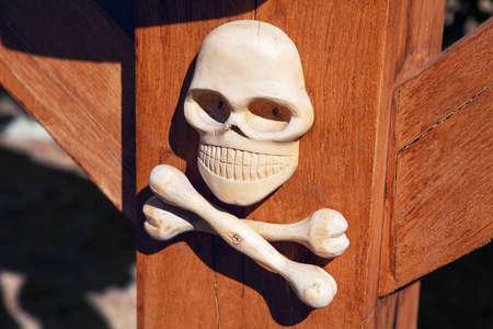 skull and bones carved by wood . The symbol of earthly death Reklamní fotografie