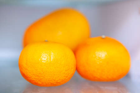 Three oranges . Exotic fruits ready to eat