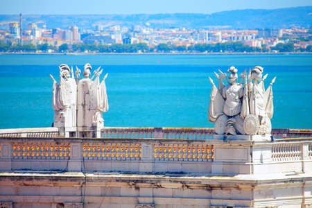 Sculptures of knights on the top of Arco da Rua Augusta in Lisbon Stok Fotoğraf