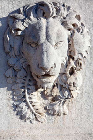 Bas relief of lion .  Animal sculpture carved into a wall Stok Fotoğraf