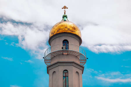 Belfry with golden dome . Church cupola in russian style 스톡 콘텐츠