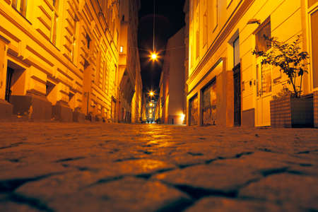 Walking along the cobblestone street in the night