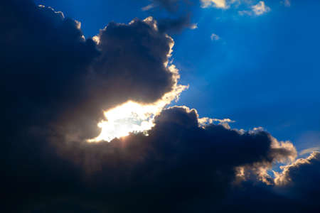 Black clouds with sunlight . Rays in dark clouds
