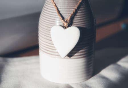 White heart made by stone . Ceramic souvenir 스톡 콘텐츠