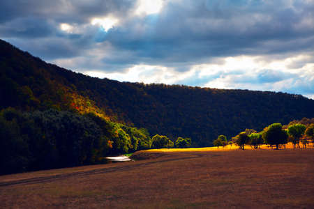 Valley surrounded by spectacular hills . Spectacular autumn landscape