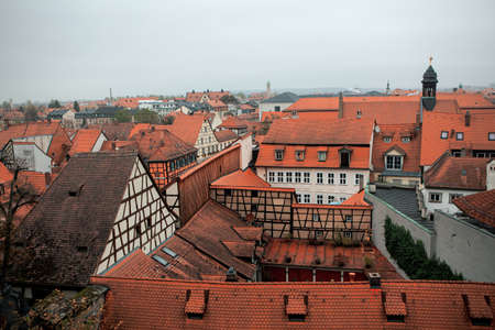 Looking overhead onto red rooftops and houses of old town