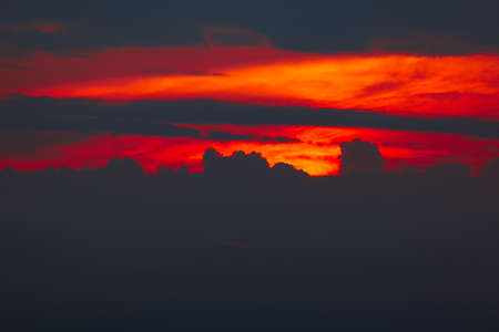 Dark and red clouds in the twilight