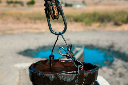Rusty bucket of old water well