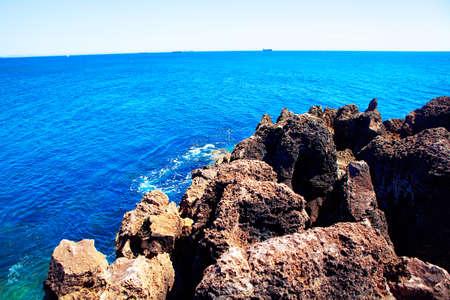 craggy coast and blue ocean