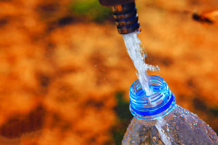 water flows into the plastic bottle