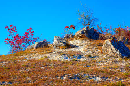 Craggy autumn hill with big rocks Stock Photo