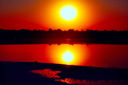 Sunset reflection in the lake water . Fantastic evening in the summer Stok Fotoğraf