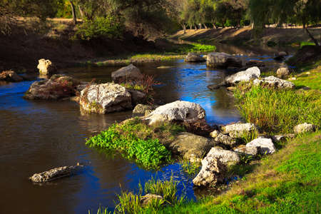 Rocks in the flowing river water