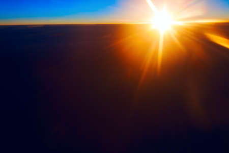 Sun above dark clouds . Fantastic sunlight view from a high height