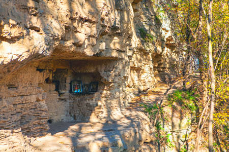 Ancient monastery with place for praying . Monk's room in the rock Stok Fotoğraf