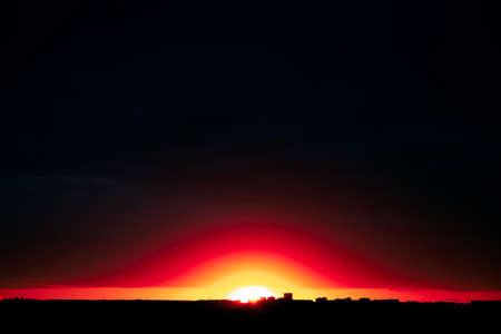 Dark sky with bright horizon at twilight